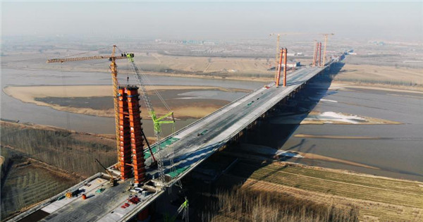 World's longest-span three-tower self-anchored suspension bridge under construction