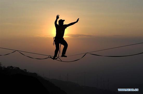 Rope walk at height of 740 meters on Mount Nglanggeran in Indonesia