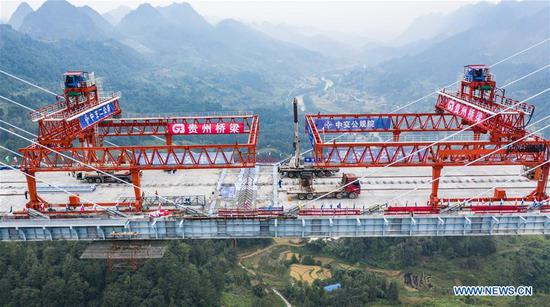 Pingtang Bridge in SW China's Guizhou completes its closure