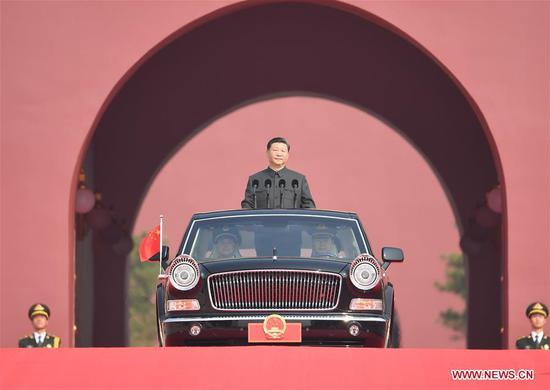 President Xi reviews armed forces on National Day for first time