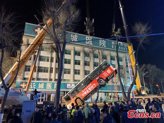 Bus crashes into sinkhole as road collapses in northwest China