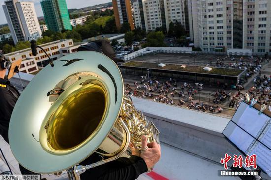 Alphorns, trumpets, tubas take to rooftops in German city for virus-safe concert